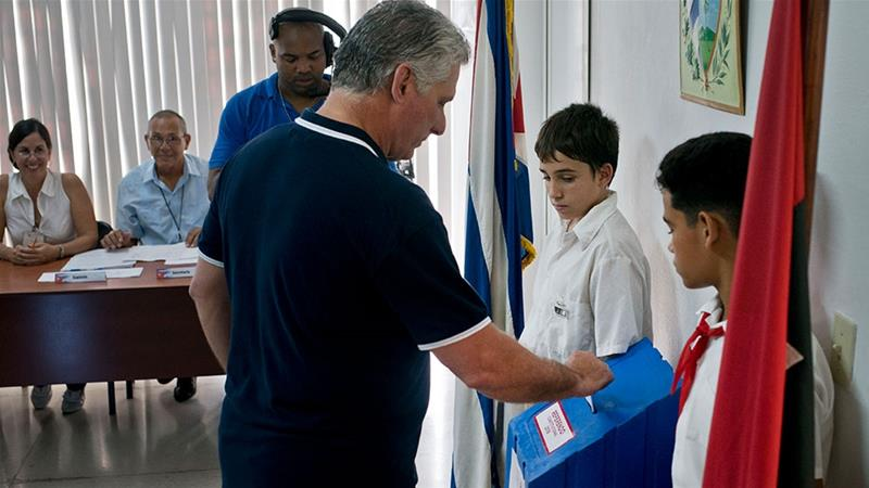 Cuban president votes during a referendum on the new constitution
