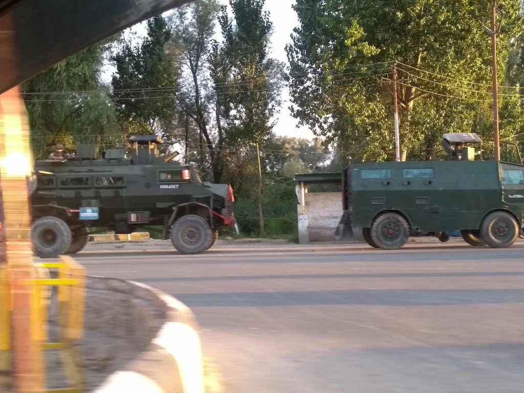 Indian military forces patrolling the deserted streets of Kashmir. (Photo: Vimalbhai)