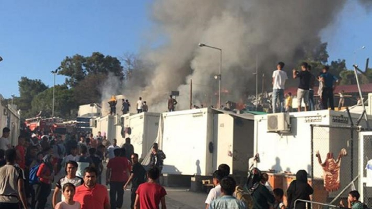 refugee camp fire Greece